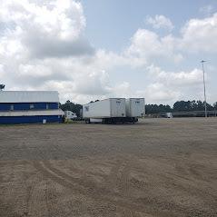 Hooks trucks parked building
