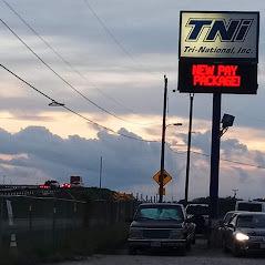 Tri national sign